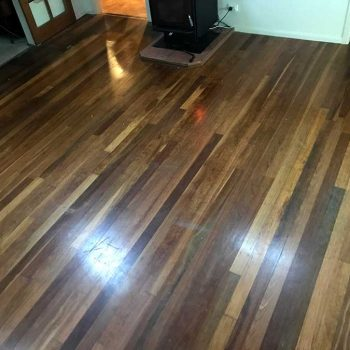 before - lounge wooden floor restoration